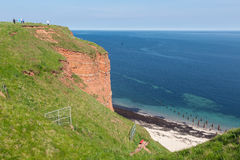 Red cliffs and beach at German island Helgoland stock photos