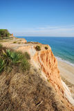 Red cliffs and blue ocean Stock Image