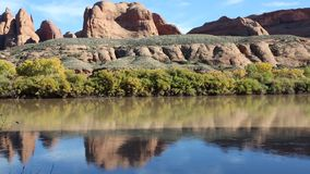 Red cliffs on Colorado River stock video footage
