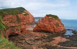 Red cliffs in Devon. Stock Photo