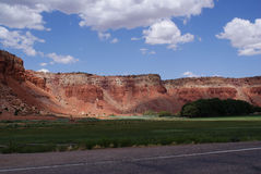 Red Cliffs and Green Pastures Stock Photos