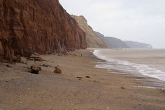Red Cliffs lining the shore of England Stock Images