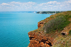 Red cliffs over the blue sea Royalty Free Stock Image