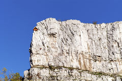 Red climber house in the rocks. Red wooden climber house in the rocks Royalty Free Stock Image