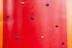 Red climbing wall, adrenaline sport theme Royalty Free Stock Photo
