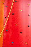 Red climbing wall, leisure activity. Red climbing wall. Leisure activity. Sport theme Stock Photos
