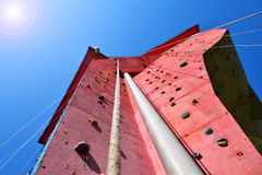 Red climbing wall Stock Image