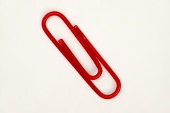 Red Clip. On paper in closeup Royalty Free Stock Image