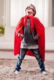 Red cloak  kid livingroom superhero Royalty Free Stock Images
