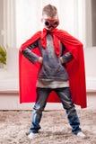 Red cloak  kid livingroom superhero Royalty Free Stock Image