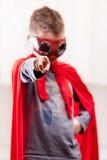 Red cloak  kid livingroom superhero Royalty Free Stock Photo