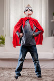 Red cloak  kid livingroom superhero Royalty Free Stock Photos