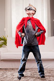 Red cloak  kid livingroom superhero Royalty Free Stock Photos