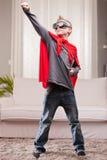 Red cloak  kid livingroom superhero Stock Images
