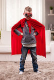 Red cloak  kid livingroom superhero Royalty Free Stock Images