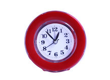 Red clock. Red clock on the white background Royalty Free Stock Photo