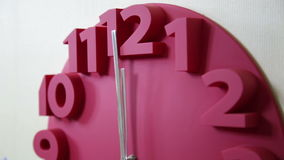 Red clock approaching midnight stock footage
