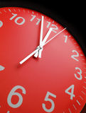Red clock face. Close up royalty free stock photo