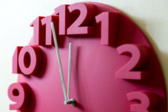 Red clock with five to midnight Stock Photo