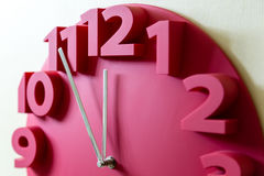 Red clock with five to midnight Stock Photography