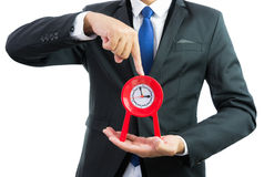 Red clock holding in businessman hands isolated Royalty Free Stock Image