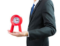 Red clock holding in businessman hands isolated Royalty Free Stock Photos