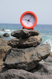 Red Clock Near the Ocean Stock Photo