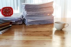 Red clock and office supplies on desk in home office royalty free stock images