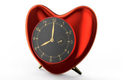 Red clock in the shape of heart Stock Image