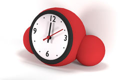 Red clock of spherical shape Royalty Free Stock Image