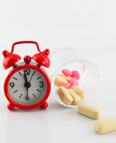 Red clock and tablet in glass on white backgroud. Show Royalty Free Stock Image