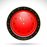 Red clock with yellow curly ornament. Holiday clock for your design Royalty Free Stock Photography