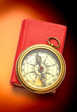 Red closed book with retro compass Stock Photos