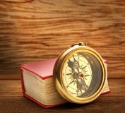 Red closed book with retro compass Stock Images