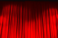 Red closed curtain with light spots in a theater Royalty Free Stock Images