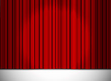 Red closed curtain with light spots in a theater Royalty Free Stock Image