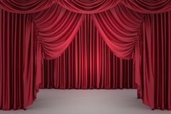Red closed the curtain, lit by a spotlight Stock Images