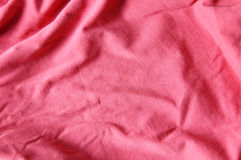 Red cloth. Background of red cloth with pleats Stock Photo
