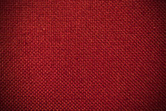 Red Cloth Background. A vintage cloth book cover with a red crosshatch pattern. Makes a nice, textured background image Stock Image