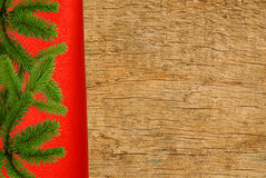 Red cloth with christmas tree branch over wooden texture Stock Images