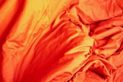 Red cloth. Crumpled bedding. stock images