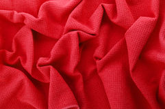 Red cloth. Crumpled elegant red fabric texture background Royalty Free Stock Photography