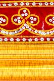 Red cloth, embroidered and gold wooden frame Royalty Free Stock Photos