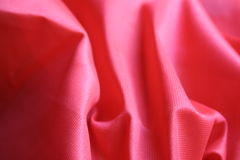 Red Cloth / Fabric. Wrinkled close up cloth or fabric with shadows and highlights royalty free stock photography