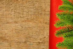 Red cloth with fir tree branch over wooden texture Stock Photo