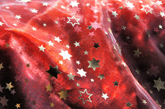 Red cloth with golden stars Royalty Free Stock Photo