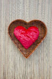 Red cloth heart symbol in wicker basket Stock Photo