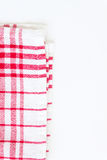Red cloth, a kitchen towel with a checkered pattern, on a white Royalty Free Stock Images