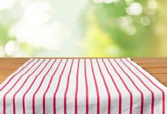 Red cloth napkin on wooden table. Red cloth napkin table green background design Royalty Free Stock Photography