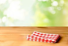 Red cloth napkin on table top Stock Images